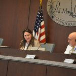 Mayor Milissa Holland anchored a 90-minute segment at Monday's Palm Coast City Council meeting, devoted entirely to refuting allegations about the city's relationship with Coastal Cloud, and the mayor's role. The mayor is a company employee. (© FlaglerLive)