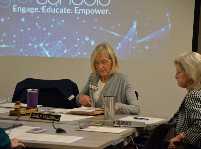 Engage. Educate. Empower. Fire: Janet McDonald, left, with School Board Attorney Kristy Gavin, who's been the in-house counsel since 2010. (© FlaglerLive)