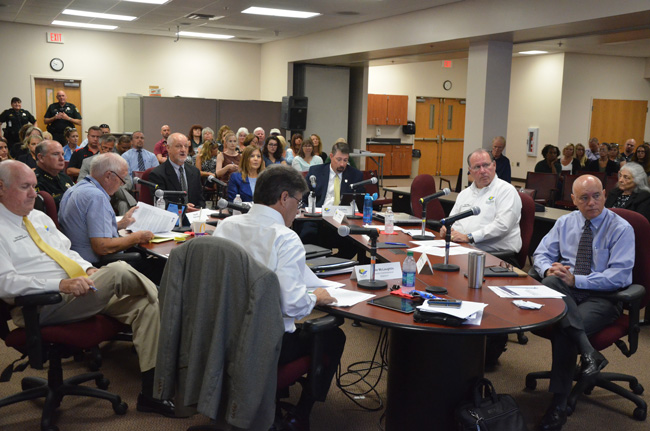 The Flagler County Commission, with Sheriff Rick Staly at the table, listens to Zdenek Hejzlar, the engineer hired to test the Sheriff's Operations Center this morning. (c FlaglerLive)
