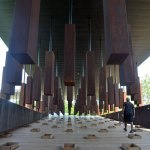 You walk out of the fierce summer sun into a shadowy forest of rectangular steel columns, row upon row of them, six or seven feet tall, covered in rust the color of dried blood. (© Pierre Tristam/FlaglerLive)