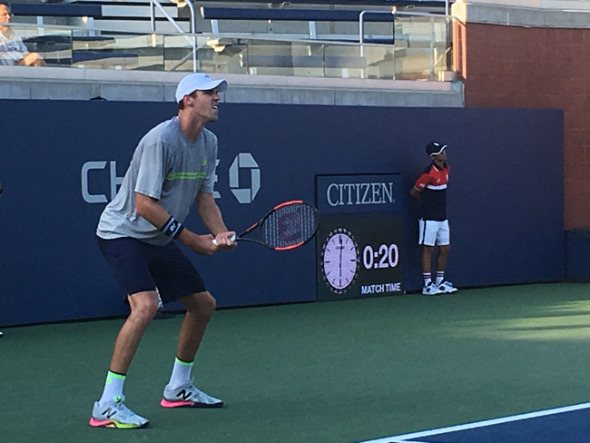 Reilly Opelka in his match at U.S. Open qualifiers Tuesday in Queens, N.Y. (© Michael Lewis for FlaglerLive)