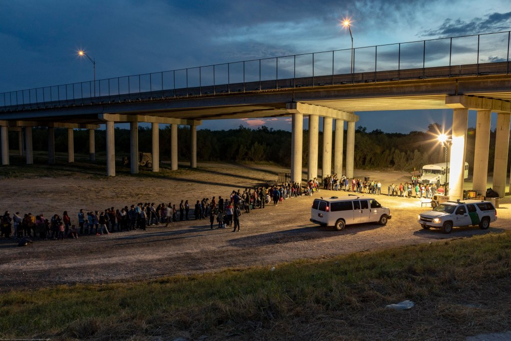Migrants that have crossed the Rio Grande surrender to U.S. Border Patrol near an area known as Rincon. From here they will be transported to a processing center. (CBP)