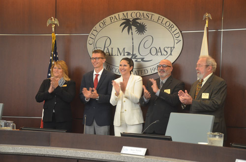 Four of the five Palm Coast City Council members are ready to see Jim Landon gone and have their own choice in the manager's chair. (© FlaglerLive)
