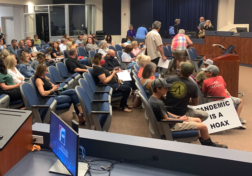 The crowd at this evening's school board meeting before the meeting started, and the pandemic sign was removed, in compliance with board rules. The meeting would get loud and raucous. (© FlaglerLive)