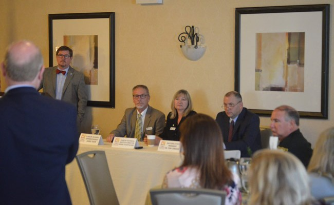 The seated panelists at this morning's Common Ground breakfast on education were, from left, Superintendent Jim Tager, Flagler Technical Institute Director Renee Stauffacher, and Daytona State College President Tom LoBasso. (© FlaglerLive)