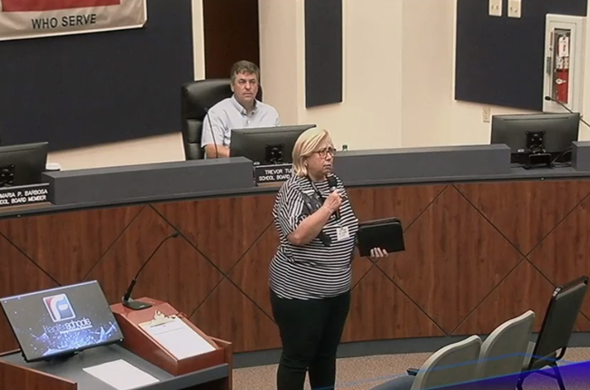 Jeanine Clontz, a pastor at Flagler Beach United Methodist Church, delivering a prayer before pitching her church to the audience at Tuesday's Flagler County School Board meeting.