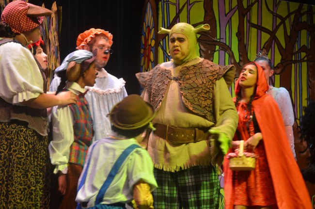 Shrek (Rafael Soto) is displeased with freaks invading his swamp as 'Shrek the Musical' begins: the big production opens at Matanzas High School's Pirate Theater with a  show for friends and family Wednesday and general public admission Thursday through Saturday. Click on the image for larger view. (© FlaglerLive)