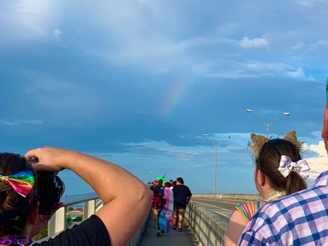 An actual rainbow briefly refracted from the marchers as they walked over the bridge. (© FlaglerLive)