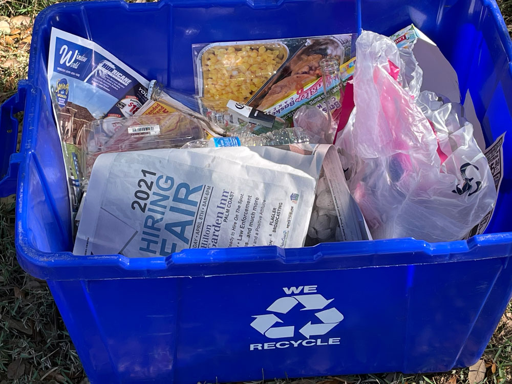 The look of recycling changed today in Flagler Beach. (© FlaglerLive)