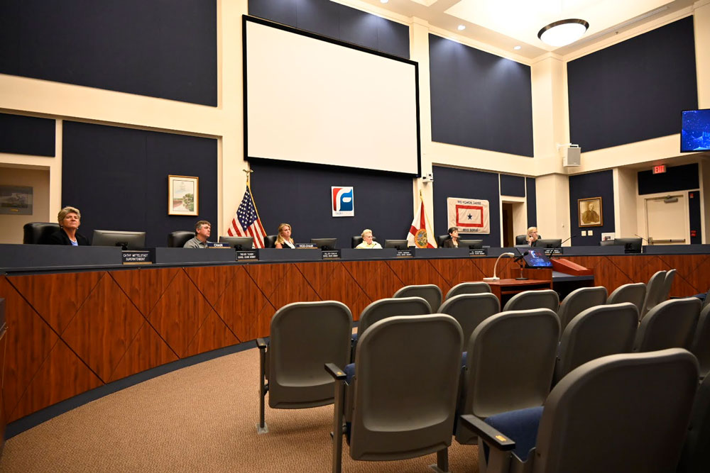 The Flagler County School Board when it last considered a mask mandate, on Aug. 17, after the chamber was cleared when members of the public were deemed to have broken the board's decorum rules. No decision meeting is scheduled until the third week of September unless the board holds an emergency meeting (© FlaglerLive)