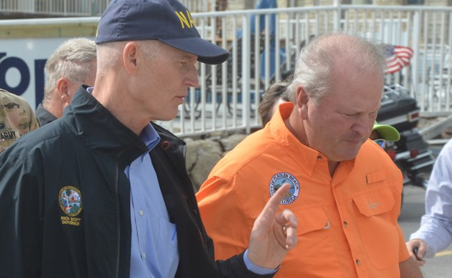 Gov. Rick Scott, not apologizing to Flagler Beach City Manager Larry Newsom. Scott vetoed a $450,000 appropriation for Flagler Beach's wastewater plant improvements. (c FlaglerLive)