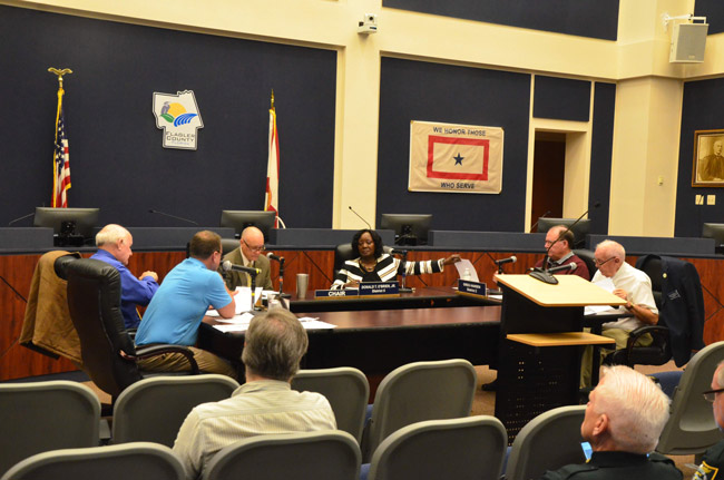 Sally Sherman, the deputy county administrator, sat with county commissioners during a special meeting this morning. Commissioners opted not to sit on the dais. (© FlaglerLive)