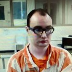 Nathaniel Shimmel, facing a first-degree murder charge in the stabbing death of his mother at their home in August 2017, as he appeared in court through video link from the jail Friday. (© FlaglerLive)