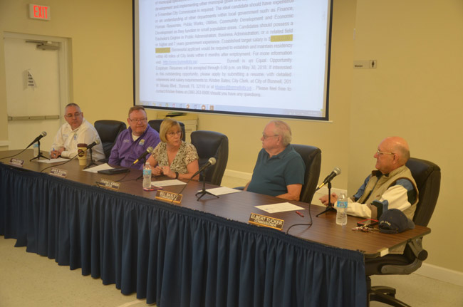The Bunnell City Commission drew up its shortlist of candidates for city manager outside of an official meeting. From left, John Sowell, John Rogers, Mayor Catherine Robinson, Bill Baxley and Elbert Tucker. (© FlaglerLive)
