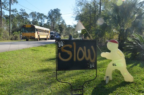 A resident's sign in front of 16 Laguna Forest Trail has long pre-dated the crash. (© FlaglerLive)