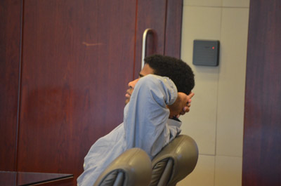 After the verdict Smith stretched but did not get up when the jury filed out: he was the only person sitting down in the courtroom. (© FlaglerLive)