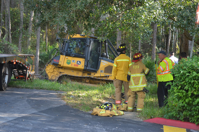 Gov. Scott  had vetoed $1.57 million for state firefighters, including employees who fight forest fires, who are frequently deployed in Flagler, as was the case above on a wildfire in Palm Coast. (© FlaglerLive)