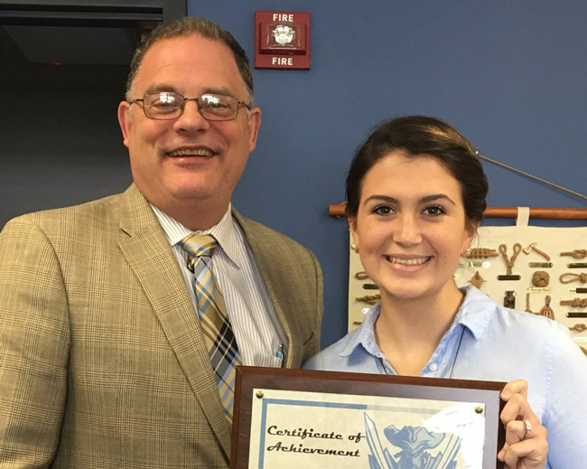 Kelsey Sweeney is this month's Senior of the Month at Matanzas High School,  where she is pictured here next to Principal Jeff Reaves. (MHS)