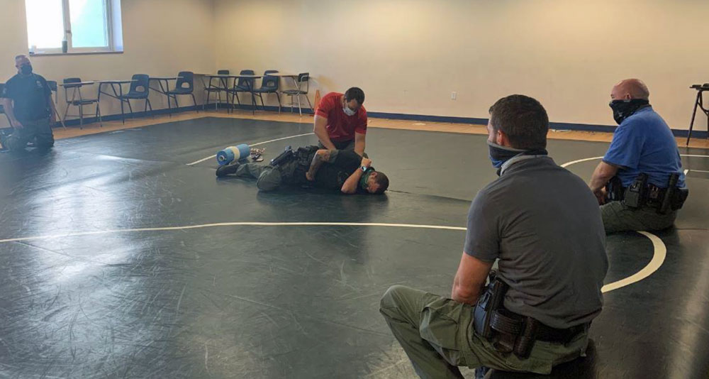 Deputy First Class Sam Bell demonstrating  a life-saving technique to the sheriff's school resource deputies. (FCSO)