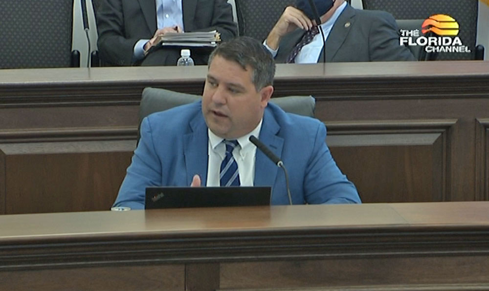 Sen. Travis Hutson speaking at today's Appropriations Committee hearing during the segment on a vacation-rental bill. Hutson voted to preserve local regulatory authority. (© FlaglerLive via Florida Channel)