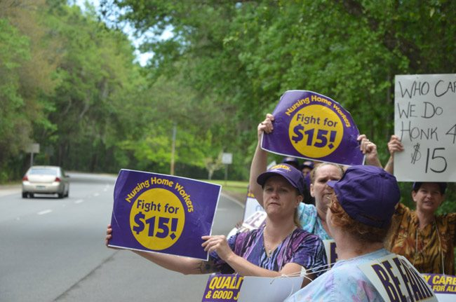 Underemployed workers at Grand Oaks, the nursing home and rehab center in Palm Coast, striking for higher wages last year. (© FlaglerLive)