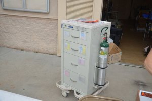 The portable emergency cart, in case of adverse reactions to the Covid-19 Moderna vaccine, sat unused today. click on the image for larger view. (© FlaglerLive)