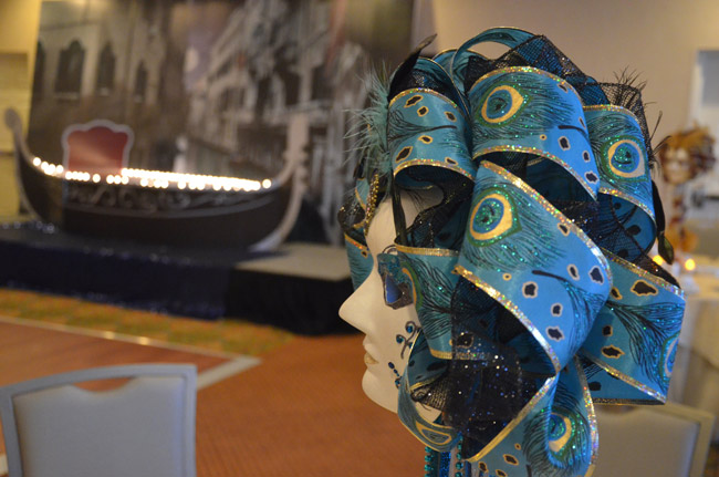 Flagler County Volunteer Services' Venice-themed masked ball and fund-raiser last Saturday raised roughly $10,000, according to