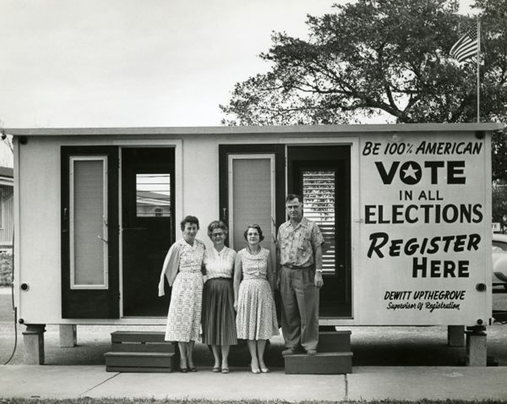 Florida law makes certain Americans less than 100 percent so. Above, officials from the Palm Beach Supervisor of Elections Office in an undated Florida Memory photo believed to be from the 1950s.
