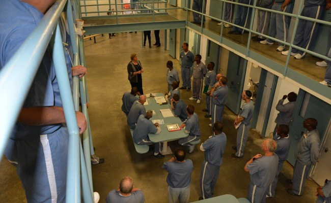 Expect fewer visiting hours. Florida prisons director Julie Jones, seen here speaking with inmates at Wakula prison, is proposing fewer visitation hours as a cost-cutting measure.