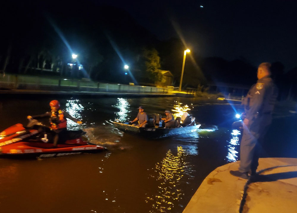 A Flagler County Fire Rescue paramedic tows the two men, stranded in a john boat for over six hours, back to shore at Bing's Landing Friday night. (FCSO)