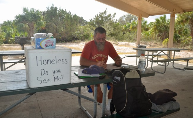 Wayne Perry, who had been the face of homelessness in Flagler, last December at a park in Flagler Beach. A county agency helped secure money through the Sheltering Tree, the volunteer organization, to pay for a bus ticket so he could travel back to Washington State. (c FlaglerLive)
