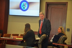Kimberle Weeks, right, with her attorneys Kevin Kulik and Ashley Kay today. Click on the image for larger view. (© FlaglerLive)