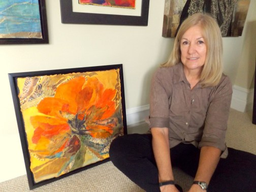 Judi Wormeck poses beside one of her mixed-media works in her 'Poppy' series. The work be part of her solo exhibition at Ocean Art Gallery in Flagler Beach. An opening reception will be 6 to 9 p.m. Friday, March 17. Click on the image for larger view. (© FlaglerLive)