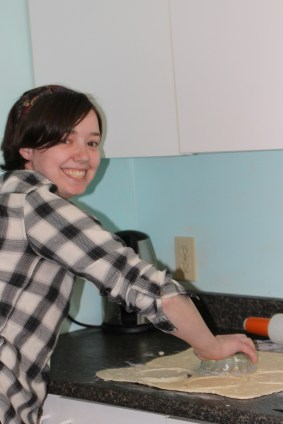 Laura happily cutting out pastry circles