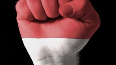 Fist raised in protest.