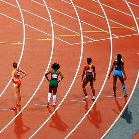 Athletics competitors line up for a race. Photo by Free-Photos/9088 images.