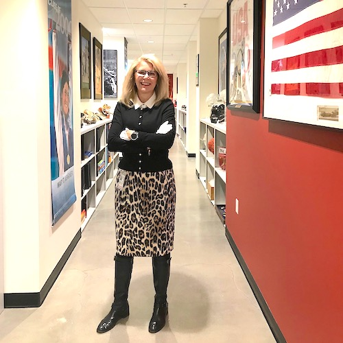 Teri Hedgpeth, archivist for the US Olympic & Paralympic Committee, stands among the team's Olympic archives. Photo courtesy of Teri Hedgpeth.