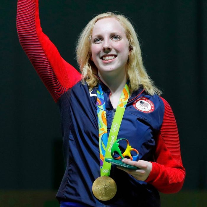 Olympic gold medalist Ginny Thrasher on the podium for winning the first medal of those Olympics, in 10m air rifle.