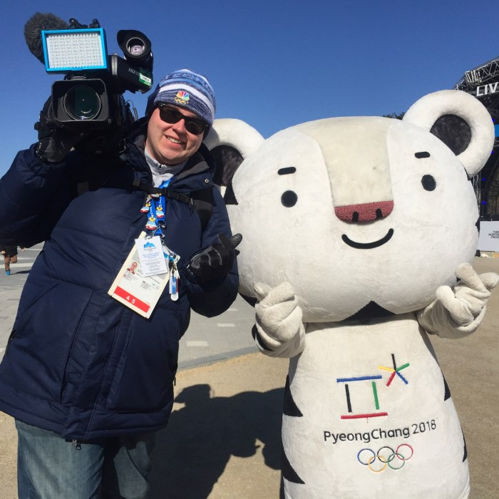 Video journalist Sean Colahan poses with PyeongChang 2018 mascot Soohorang at the 2018 Olympics in South Korea.