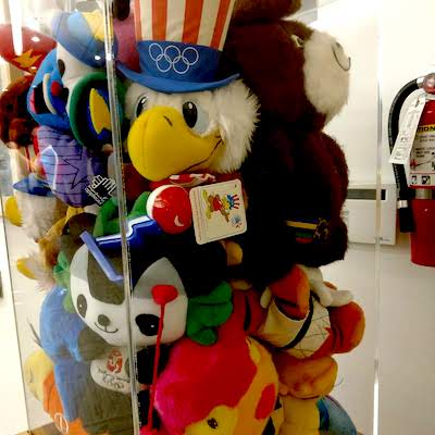 Olympic mascots in a display case.