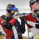 SPC Tim Sherry shooting an air rifle in competition.
