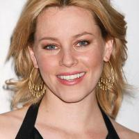 Julie Bowen vs. Elizabeth Banks:  Who wins this matchup of perky blondes?
