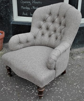 re-upholstered iron back chair deep buttoned