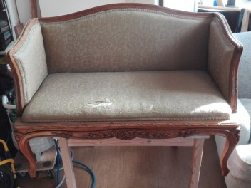 Antique sofa in need of re-upholstery