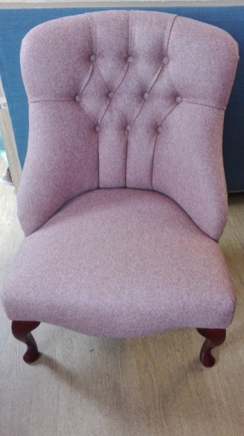 re-upholstered deep buttoned chair in Moon wool