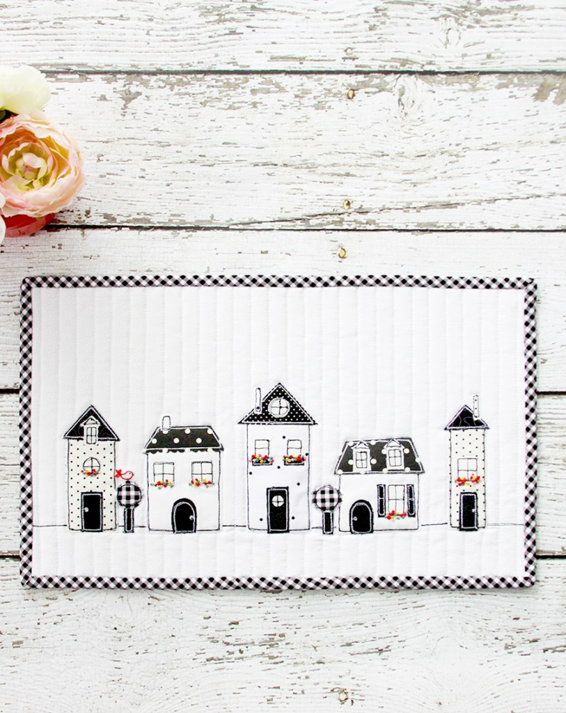 2019 Top Ten Quilting and Sewing Projects! by popular Tennessee quilting blog, Flamingo Toes: image of a black and white neighborhood mini quilt.