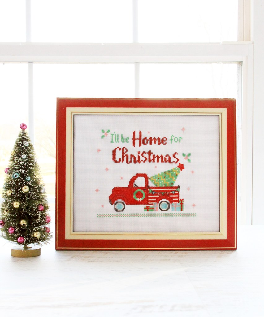 I'll Be Home for Christmas Cross Stitch Pattern by popular Tennessee quilting blog, Flamingo Toes: image of a framed Christmas cross stitch pattern.