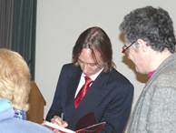 Stuart signs for an enthusiastic Flamsteed audience