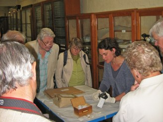 Dr Rebekah Higgitt shows the group items from the reserve collection