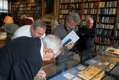 Flamsteed members take a close look at some of the historic books and photographs